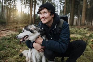 Person with a cute white-black husky dog in the forest with sunset. Outdoor autumn mood. Enjoy life and lovely friendship with with a pet. - Stock Photo or Stock Video of rcfotostock | RC-Photo-Stock