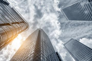 Perspective and underside angle view modern glass building skyscrapers over cloudy sky : Stock Photo or Stock Video Download rcfotostock photos, images and assets rcfotostock | RC-Photo-Stock.: