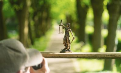 photographer taking a photo of the Statue of Justice - lady justice or Iustitia / Justitia the Roman goddess of Justice : Stock Photo or Stock Video Download rcfotostock photos, images and assets rcfotostock | RC-Photo-Stock.: