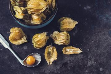 Physalis fruits (Physalis Peruviana) with in a ceramic bowl and spoon on dark background- Stock Photo or Stock Video of rcfotostock | RC-Photo-Stock