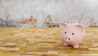Piggy bank in a room with brick wall, copyspace for your individual text.- Stock Photo or Stock Video of rcfotostock | RC-Photo-Stock
