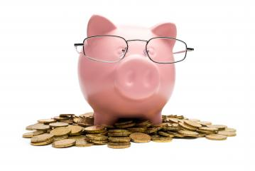 Piggy bank on a coin heap- Stock Photo or Stock Video of rcfotostock | RC-Photo-Stock