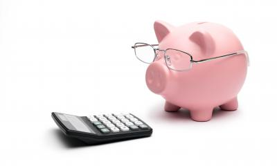Piggy Bank with calculator on white background- Stock Photo or Stock Video of rcfotostock | RC-Photo-Stock