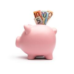 Piggy Bank with euro note on white- Stock Photo or Stock Video of rcfotostock | RC-Photo-Stock