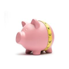 Piggy bank with tape measure on white background- Stock Photo or Stock Video of rcfotostock | RC-Photo-Stock
