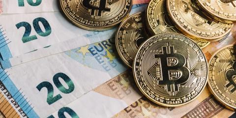 pile of cryptocurrency Bitcoins, on top of Euro banknotes- Stock Photo or Stock Video of rcfotostock | RC-Photo-Stock