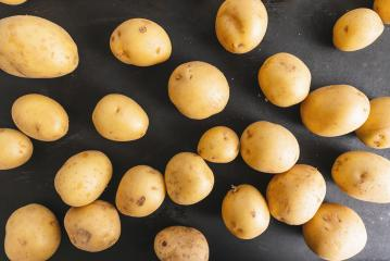 Pile of potatoes lying on board- Stock Photo or Stock Video of rcfotostock | RC-Photo-Stock