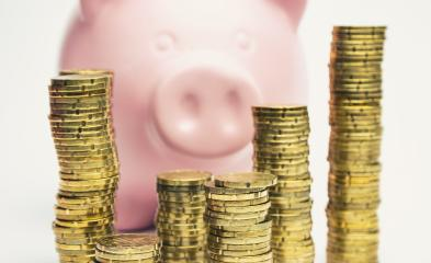 Pink Piggy Bank behind stacked coins - money concept image- Stock Photo or Stock Video of rcfotostock | RC-Photo-Stock