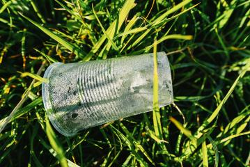 Plastic cup pollution on a meadow- Stock Photo or Stock Video of rcfotostock | RC-Photo-Stock