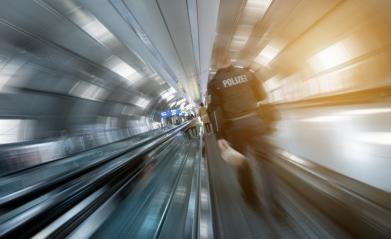 Police man at a walking on a airport : Stock Photo or Stock Video Download rcfotostock photos, images and assets rcfotostock | RC-Photo-Stock.: