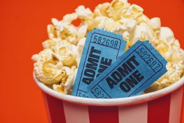 Popcorn box with cinema movie tickets- Stock Photo or Stock Video of rcfotostock | RC-Photo-Stock