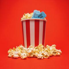 Popcorn box with cinema movie tickets on a bright red background- Stock Photo or Stock Video of rcfotostock | RC-Photo-Stock
