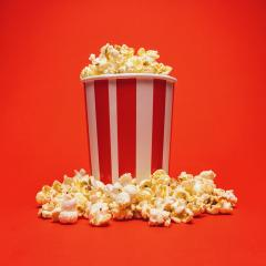 Popcorn in a box around on a bright red background- Stock Photo or Stock Video of rcfotostock | RC-Photo-Stock