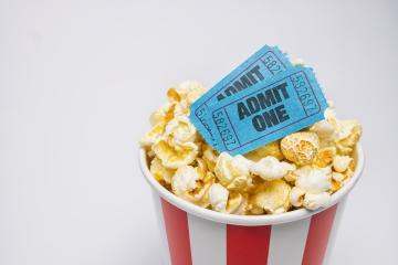 popcorn in a box with cinema tickets on gray background : Stock Photo or Stock Video Download rcfotostock photos, images and assets rcfotostock | RC-Photo-Stock.: