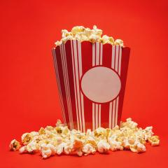 Popcorn in a large square box and around on a bright red background.- Stock Photo or Stock Video of rcfotostock | RC-Photo-Stock