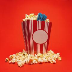 Popcorn with cinema tickets in a large square box and around on a bright red background.- Stock Photo or Stock Video of rcfotostock | RC-Photo-Stock
