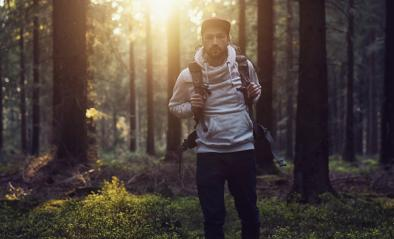 Portrait of a young hiker with backpack in the forest at a summer day : Stock Photo or Stock Video Download rcfotostock photos, images and assets rcfotostock | RC-Photo-Stock.: