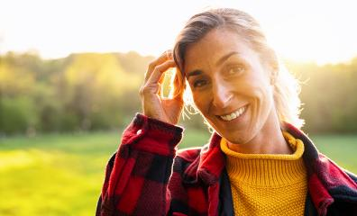 Portrait of beautiful mature woman smiling and looking away at park during sunset. Outdoor portrait of a smiling girl. Happy cheerful girl laughing at park with checkered shirt. : Stock Photo or Stock Video Download rcfotostock photos, images and assets rcfotostock | RC-Photo-Stock.: