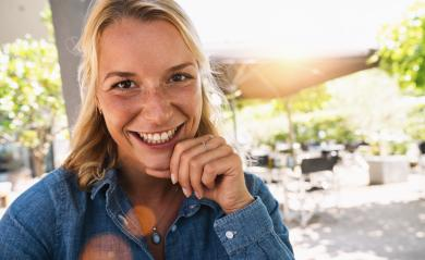 Portrait of happy mature woman looking at camera. Closeup face of smiling woman sitting in cafeteria with hand on chin. Successful lady in a cafe pub.- Stock Photo or Stock Video of rcfotostock | RC-Photo-Stock