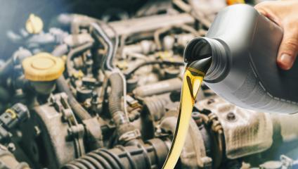 Pour motor oil into car engine. Maintenance service change liquids and fluid.- Stock Photo or Stock Video of rcfotostock | RC-Photo-Stock