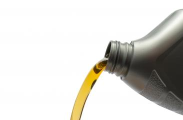 Pouring oil from bottle on isolated white background- Stock Photo or Stock Video of rcfotostock | RC-Photo-Stock