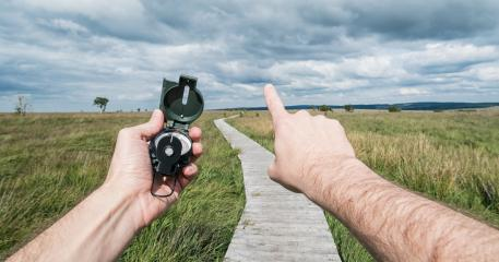 POV image of traveler man holding a compass and pointing direction in the landscape. : Stock Photo or Stock Video Download rcfotostock photos, images and assets rcfotostock | RC-Photo-Stock.: