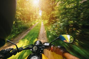 POV shot of young man riding on a motorcycle at tour in the forest. copyspace for your individual text.- Stock Photo or Stock Video of rcfotostock | RC-Photo-Stock