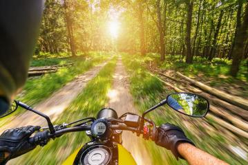 POV shot of young man riding on a motorcycle. motorcycle tour journey in the forest. copyspace for your individual text.- Stock Photo or Stock Video of rcfotostock | RC-Photo-Stock