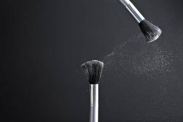 powderbrush on black background- Stock Photo or Stock Video of rcfotostock | RC-Photo-Stock