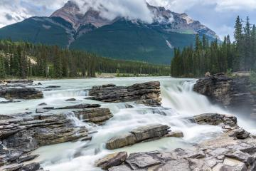 Powerful picturesque waterfall Athabasca. Pyramidal mountain covered with the first snow. Canada, Jasper National Park : Stock Photo or Stock Video Download rcfotostock photos, images and assets rcfotostock | RC-Photo-Stock.: