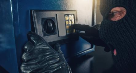 Professional burglar in black ski mask opened a small safe : Stock Photo or Stock Video Download rcfotostock photos, images and assets rcfotostock | RC-Photo-Stock.: