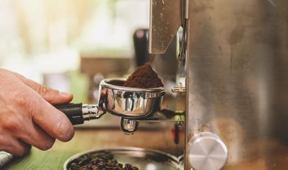 Professional grinding mechanism. Barista grind coffee beans using coffee machine. Coffee grinder grinding roasted beans into powder. Fresh ground coffee in portafilter. Barista makes espresso in cafe- Stock Photo or Stock Video of rcfotostock | RC-Photo-Stock