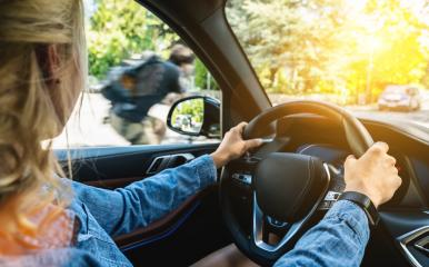 Rear view of attractive young woman in casual wear looking carefully to the road while driving a car.- Stock Photo or Stock Video of rcfotostock | RC-Photo-Stock