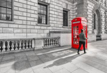red british phone booth with walking woman in London England UK. - Stock Photo or Stock Video of rcfotostock | RC-Photo-Stock