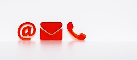 red contact icons leaning against a wall as a hotline and service panorama concept - Stock Photo or Stock Video of rcfotostock | RC-Photo-Stock