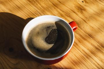 red Cup of coffee on wooden table, top view- Stock Photo or Stock Video of rcfotostock | RC-Photo-Stock