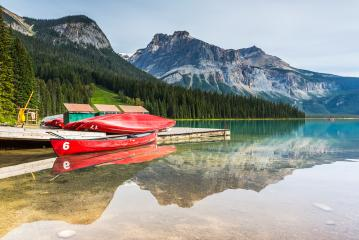 Red kayaks at Emerald Lake in Canadian Rockies, Yoho National Park, Alberta, Canada : Stock Photo or Stock Video Download rcfotostock photos, images and assets rcfotostock | RC-Photo-Stock.: