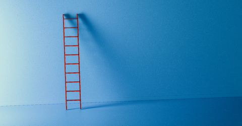 Red ladder leans against a blue wall background, copyspace for your individual text.- Stock Photo or Stock Video of rcfotostock | RC-Photo-Stock