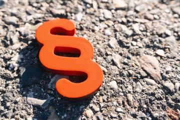 red paragraph symbol for the idea of Justitia and law on the street- Stock Photo or Stock Video of rcfotostock | RC-Photo-Stock