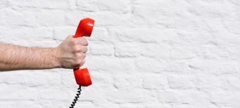 red phone call for you against a white brick wall- Stock Photo or Stock Video of rcfotostock | RC-Photo-Stock