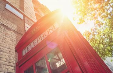 Red Telephone Booth with sun at summer in London street- Stock Photo or Stock Video of rcfotostock | RC-Photo-Stock