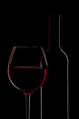 Red Wine Bottle silhouette and a Wine Glass on Black Background : Stock Photo or Stock Video Download rcfotostock photos, images and assets rcfotostock | RC-Photo-Stock.: