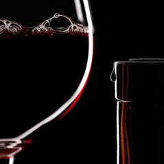 Red Wine Glass silhouette on Black Background with Bubbles and bottleneck with a drop : Stock Photo or Stock Video Download rcfotostock photos, images and assets rcfotostock | RC-Photo-Stock.: