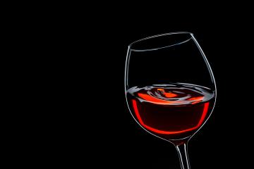 red wine swing on black- Stock Photo or Stock Video of rcfotostock | RC-Photo-Stock