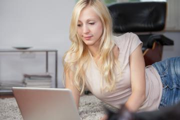 Relaxed woman is using laptop- Stock Photo or Stock Video of rcfotostock | RC-Photo-Stock