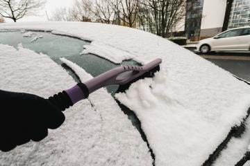Removing snow from car windiow with a brush- Stock Photo or Stock Video of rcfotostock | RC-Photo-Stock