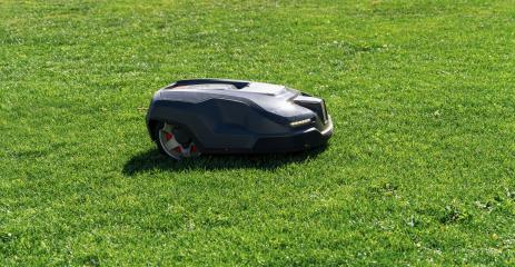 Robotic lawn mower mows the lawn in a garden- Stock Photo or Stock Video of rcfotostock | RC-Photo-Stock
