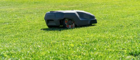 Robotic lawn mower on grass. copyspace for your individual text.- Stock Photo or Stock Video of rcfotostock | RC-Photo-Stock