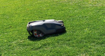Robotic lawn mower on grass, side view- Stock Photo or Stock Video of rcfotostock | RC-Photo-Stock