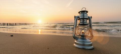 romantic evening at the beach, vintage lantern at sunset, banner size, copyspace for your individual text- Stock Photo or Stock Video of rcfotostock | RC-Photo-Stock